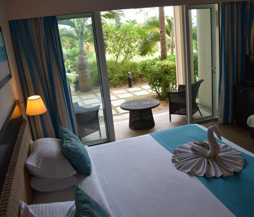 Pearle Beach Resort & Spa / Deluxe Garden view room - hálószoba (Mauritiusi utazások)